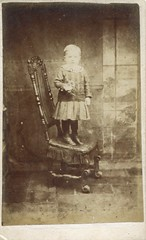 Portrait of a young boy by H. Thomas (undated) (pellethepoet) Tags: boy portrait cute chair toddler child little thomas young skirt photograph cdv cartedevisite teignmouth studiofurniture hthomas