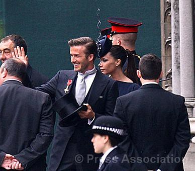 David and Victoria Beckham by The British Monarchy