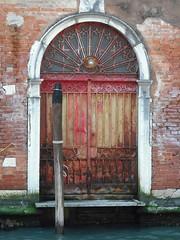 Cannaregio Doorway (Flamenco Sun) Tags: venice light italy canal italia shadows lagoon carnivale gondola venetian venezia gondolier burano lido vaporetto dorsoduro veneto ventian accademia cannaregio guidecca smarco