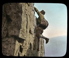 Rock Climber on Castle Mountain (glenbowmuseum) Tags: old cliff vintage rockies mountainclimbing rockymountains archival nationalparks rockclimbing mountaineer magiclantern glassslides mountainscenery lanternslides glenbowarchives