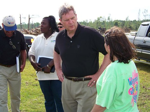 Secretary Tom Vilsack toured the area of Smithville, Mississippi and saw firsthand the heavy damage caused by the tornado. He is seen in this photo talking to one of the victims of the disastrous weather. Behind him is USDA Rural Development State Director Trina George of Mississippi. Secretary Vilsack and State Director George were two of a number of Obama Administration Cabinet officials, federal administrators, and local leaders to see the damage caused by tornadoes in Mississippi and Alabama.