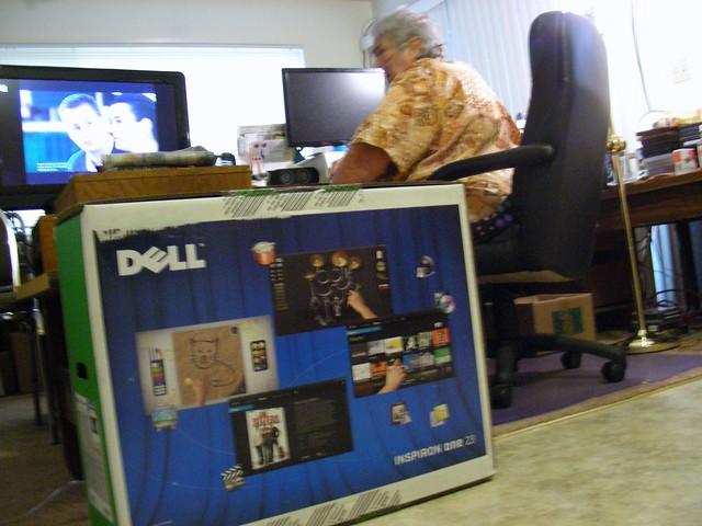 Sylvia takes a breather before we start clearing her desk to set up the new computer
