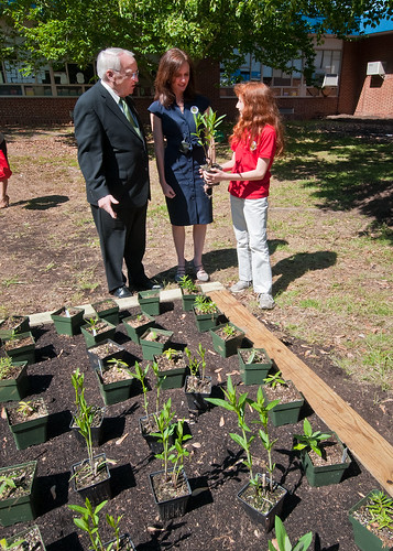 Dr. Kevin Concannon (left), Undersecretary, Food Consumer and Nutrition Services,  Dr. Elizabeth Hagen (center), Undersecretary, Food Safety and Emily Wise (right), a fifth grade student at Maryland City Elementary School in Laurel, MD, discuss the plants native to Maryland that will be going into the school garden. Undersecretary Concannon and Undersecretary Hagen were at Maryland City Elementary for the USDA, Food Safety Inspection Service, Food Safety Education Camp on Thursday, May 5, 2011. USDA Photo by  Bob Nichols.