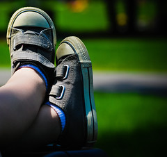 Chucks relaxing (chrishayworth) Tags: county summer baby hot green girl grass canal toddler downtown nap day legs indianapolis low sunday may indy marion taylor chuck velcro harper tops chucks crossed hayworth naptown