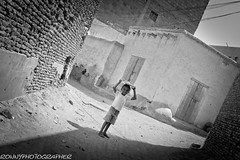 child in the Historic Town of Zabid-yemen (anthony pappone photography) Tags: trip travel boy blackandwhite bw baby white black blancoynegro kids canon children photo photographer child image photos bambini historic unesco arab arabia childrens yemen enfants fotografia crianças storico 儿童 arabo yemeni phototravel 子供 الأطفال yaman дети medioriente и 兒童 черное أبيض arabie bambine jemen zabid childrentravel losniños arabiafelix اليمن arabianpeninsula وأسود 黑與白 portraitsofchildren белое يمني बच्चे 也門 йемен 공화국 yemenpicture yemenpictures 아랍 यमन 예멘 mark5dii thiama mediorient