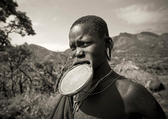 Surma woman with big lip plate in Tulgit - Omo Ethiopia (Eric Lafforgue) Tags: africa people woman colour horizontal female outside outdoors person plateau femme clay omovalley ethiopia tribe surma personne humanbeing argile bodymodification labret contemplation afrique tribu dehors omo eastafrica 882 suri abyssinia ethiopie exterieur lookingatcamera traditionalclothes piercedlip abyssinie vueexterieure coloredpicture lipplug lipplate photocouleur stretchedlip afriquedelest surmatribe etrehumain habittraditionnel tulgit suripeople valleedelomo peuplenomade regardantlobjectif lipdisc plateaulabial turgit peoplesoftheomovalley piercedhole piercedlipornament surmapeople peuplesdelavalleedelomo villageofturgit villagedeturgit tribudessuri suritribe tribudessurma peuplesuri peuplesurma colouredpicture levreetiree levrepercee ornementdelevrepercee femmeaplateau