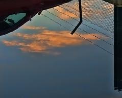 Reflections in a carpark. (dicktay2000) Tags: sunset reflection rain sydney australia topaz g11 sevenhills thechallengefactory richardtaylor 20110429img1721