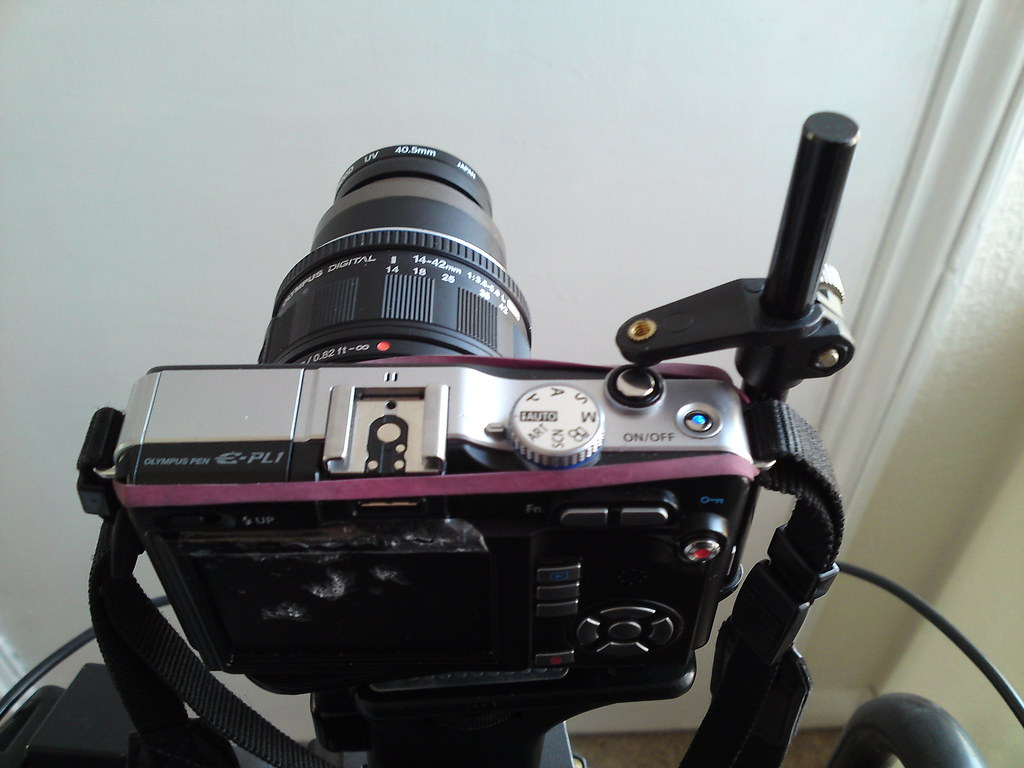 Makeshift device to hold the shutter down for continuous shooting