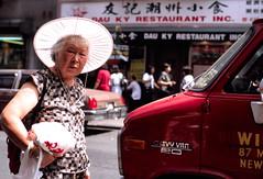 Chinatown '98 #8 (stillsguy) Tags: street old nyc light summer woman white cars hat truck canon shopping back chinatown fuji bokeh 85mm pedestrians backlit reala eos1n f12 stinkeye bokehlicious