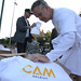 Frank Thompson (CAF) giving out t-shirts for CAM Raleigh bike ride.