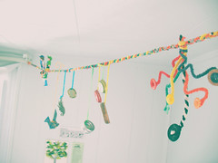 hanging in my room 4 (incompletethoughts) Tags: vintage origami colorful yarn string foundobjects bottlecap pipecleaners whimsical vintagestyle pipecleaner origamibird
