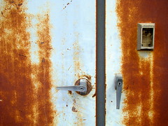 simplicity (skylinejunkie) Tags: door orange white lines rust diptych industrial decay rusty corrosion handles