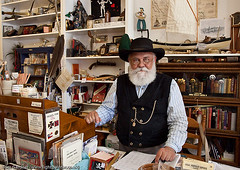 Old-time gold-rush town shopkeeper and shop (uatreeboy) Tags: california park county old usa white man male tourism hat shop museum america shopping beard glasses costume state antique traditional unitedstatesofamerica 19thcentury working conservation columbia tourist historic american era northamerica vest preserved sales period wildwest americas clutter waistcoat salesman bricabrac californian preservation oldfashioned motherlode goldcountry shopkeeper bushy distinguished oldendays bygone tuolumnecounty