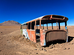 Bolivia S90-100531-082 (Kelly Cheng) Tags: travel color colour bus abandoned tourism southamerica nature sunshine horizontal landscape daylight colorful day desert outdoor transport vivid sunny bolivia bluesky nobody nopeople colourful copyspace altiplano traveldestinations pickbykc