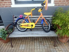 Bike Sitting On Bench (Quetzalcoatl002) Tags: bike childrensbike bench kinderfiets colorful street amsterdam streetshots