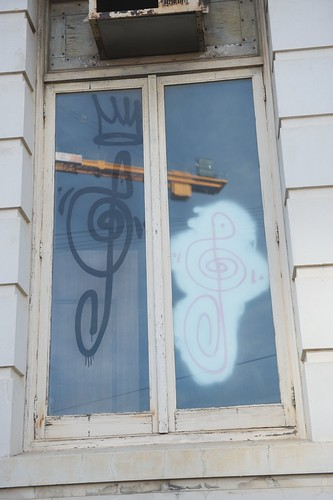 graffiti of a bass clef on a window