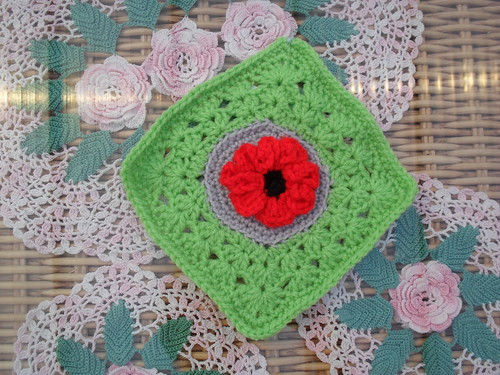 This could be a brightly coloured 'tropical flower?' I think....Thanks so much crochet3love! I love your Squares and........>