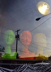 sunbathing (jodipdx) Tags: light orange reflection green mannequin yellow portland wire heads telephonepole