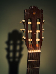 Head and Shadow (jaxxon) Tags: shadow music vintage neck 50mm nikon mood moody bokeh guitar head pad retro spanish musical instrument acoustic classical strings 365 nikkor vignette nylon fiddy headstock frets 50mmf18 2011 d90 project365 niftyfifty jaxxon jackcarson multifarious apicaday ayearinpictures nikond90 119365 hpad project365119 365119 desklickr jacksoncarson jacksondcarson fiftyfriday ayearinphotographs hpadw project3652011 2011yip 3652011 yip2011 2011ayearinpictures fiddyfriday 2011365119 project3651192011
