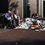 Elderly people and a pile of trash thumbnail