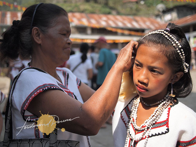 A girl being prepped for their group's performance