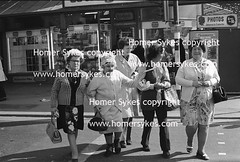 WORKING CLASS 1970S FAMILY HOLIDAY OUTING SENIOR HEN DO UK (Homer Sykes) Tags: uk party england woman english senior golden 1974 women do britain lancashire mature elderly older 70s british generations 1970s granny hen blackpool mile oap goldenmile gbr girlsdayout henparty hendo britishsociety travelstock archivestock