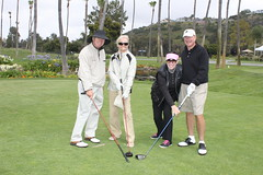 Jim Stein, Sharon Stein, Joyce Morris, and Jim Morris Show Off Their Team Spirit