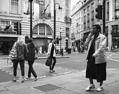 Friday is THE casual day ! (Pierre Mallien) Tags: street people urban bw guy london fashion canon shopping fun eos cool aperture funny flickr raw day phone dress circus robe pierre candid pit explore jungle oxford londres metropolis streetphoto casual jupe friday rue regent mode catwalk vendredi viernes londonist photoderue comique rawstreet pitvanmeeffe 5dmark2 mallien pierremallien lemeilleurphotographedemariagedebelgique