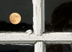 Yellow moon on the rise ... (Canadapt) Tags: moon reflection window cross frame neilyoung helpless lunareclipse canadapt