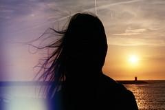 But unlike most people (maggyvaneijk) Tags: ocean light shadow sea orange sun film beach water set sunrise 35mm dark hair neck haze darkness minolta scheveningen horizon den north violet haag leak
