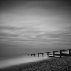 Echo beach (martinfowlie) Tags: wood longexposure sea sky blackandwhite mist beach water monochrome clouds canon square suffolk stones shingle pebbles le 7d nd groyne echobeach marthaandthemuffins 238seconds