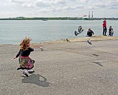 Chasing Pigeons (Reinardina) Tags: girl movement child candid pigeons hampshire chase southampton mayflowerpark sreetphotography