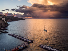 Sorrento Sundown Storm (Johnners61) Tags: sorrento italy europe amalfi coast sea ocean storm sunset sundown drama dramatic luminous glow yacht boat ship pier cloud cloudy sun olympus pen olympuspen microfourthirds micro four thirds mft m43 holiday vacation italia dusk evening twilight campania