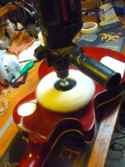 Buffing this brand new Les Paul to remove the satin finish on the back - guitar finishing in Manchester/Salford (Jack's Instrument Services) Tags: from rose manchester tech tales action bass guitar low workshop instrument files acoustic bone setup jacks fret salford luthier services workbench pickups guitartech restring repairer guitarsetup respray refret defret brokenheadstock headstockbreak fretdress lowaction guitarrepairs guitaraction paintingguitar talesfromtheworkbench thefretfiles guitarsetups guitarrepairermanchester pickuprewind pickupwinding fretremoval fretlevel stoneandreprofile pickguardscratchplateguitar refinishguitar nutbone saddlefloyd