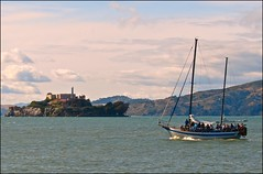 alcatraz....island in the bay (ana_lee_smith) Tags: ocean sanfrancisco california travel blue sky lighthouse tree green broken window water glass yellow ferry clouds sailboat island photography freedom bay sailing tour escape view photos seat steps perspective cell tourist prison sail alcatraz cypress therock bleachers solitary audio cracked attraction 1946 jailhouse confinement federalprison guardtower nationalhistoricsite exerciseyard federalpenitentiary analeesmith 19331963 islandofpelicans alcatrazpictures thebattleofalcatraz
