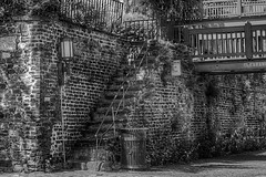 (HisAndHerPhotographs.com) Tags: old bridge bw brick history lamp stairs ga fence georgia 50mm blackwhite downtown noparking rail historic stairway cobblestones cobblestone adobe savannah southeast trashcan railing clearance lightpost hdr sav lightroom historicdistrict photomatix niftyfifty 3exposure canon50d rrstripod tvc33