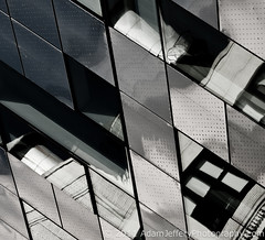 Metallic Water Towers (adamjefferyphotography) Tags: nyc white black reflection glass metal watertower highlinepark