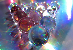 Spheres, colours and rainbows (Oakwood30) Tags: blue light red sunlight reflection circle rainbow spectrum sphere round refraction transparent polymer superbasorbent