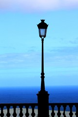 upright (Wackelaugen) Tags: blue sea sky lamp silhouette canon fence photography eos photo spain europe tenerife lantern upright puertodelacruz puertocruz