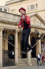 Fiddler on a slackrope. (Tuppence 2009) Tags: red musician bath streetphotography 71 explore violin streetperformer fiddle busker violinist fiddler pumproom balancingact slackrope slackwire fz38 mygearandme 111picturesin2011