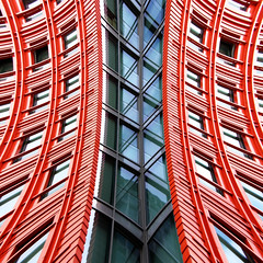 Side Splitting (Andrea Kennard) Tags: city blue light red wallpaper sky urban orange abstract detail reflection building art texture window glass colors lines silhouette yellow wall architecture modern illustration facade skyscraper work poster square corporate mirror design office high construction colorful downtown pattern technology exterior shine dynamic bright artistic background steel stripes perspective structure architectural business reflected block elegant isolated futuristic element linear finance doublyniceshot