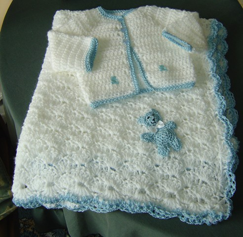 Baby crochet jacket and  pram rug.