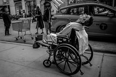 A strange dream (Giovanni Savino Photography) Tags: newyorkcity newyork smiling sleep taxi wheelchair shoppingcart newyorkstreets newyorkstreetphotography magneticart giovannisavino