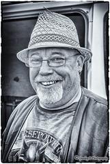 """FatBoy"" #36 of 100 Strangers (sparkeyb) Tags: street portrait bw smile hat 35mm beard mono glasses blackwhite nikon streetphotography monotone d200 f18 bandw 36 35 100strangers silverefex sparkeyb"