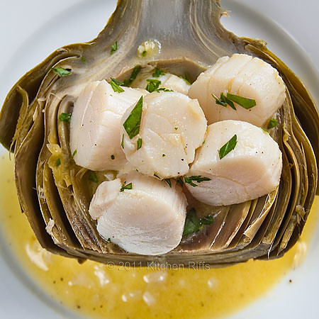 Poached Scallops in an artichoke scoop on plate with mustard vinaigrette, overhead view