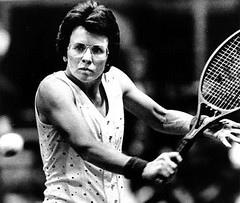 black and white photo of Billie Jean King swinging a tennis racket
