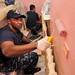 USS Carr Sailor paints a wall during a communi...