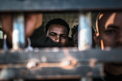 Behind Bars (KarimHddd) Tags: work fuji prison migration libya detention migrants