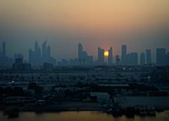 Sunset in Dubai (Tigra K) Tags: dubai unitedarabemirates ae 2013 architecture boat city hotel spire stream sunset tower railroad