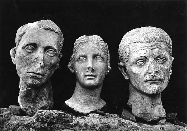 """Muse and portraits of citizens"" excavation photo of the heads of three Roman sculptures from Minturnae, Italy, 1931-1933. Penn Museum image #182924"